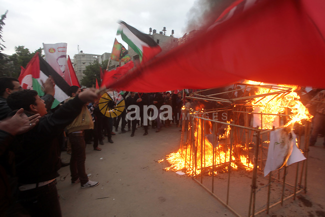 Palestinian supporters of Palestinian People's Party burn a symbolic jail during a demonstration in solidarity with hunger-striking Palestinian prisoners held by Israel, demanding their release in Gaza city on Feb, 10, 2013. Photo by Ashraf Amra