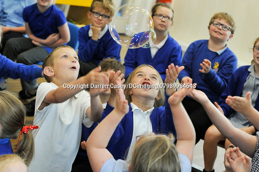 Pictured at Paull Primary School is David Price from Science Made Simple and National Grid. David is demonstrating the science of bubbles to the key stage one pupils.   Pictures copyright Darren Casey / DCimaging 07989 984643