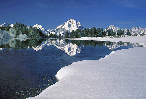 Reflection of Mount Moran in the Snake River, Grand Teton National Park, Jackson, Wyoming. John offers private photo tours in Grand Teton National Park and throughout Wyoming and Colorado. Year-round.