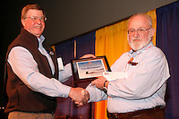 "Thursday March 4, 2010      .Leo Rasmussen (R) accepts the "" Founders Award "" from Iditarod Race Foundation president John Norman at the musher's drawing banquet in Anchorage ..."