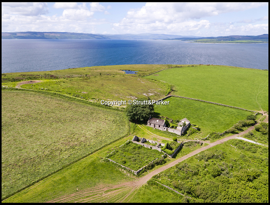 BNPS.co.uk (01202 558833)<br /> Pic:  Strutt&Parker/BNPS<br /> <br /> Redundant houses and buildings on the island.<br /> <br /> A stunning Scottish island has emerged for sale for just £1.4million - the cost of a London terraced home.<br /> <br /> Inchmarnock, at the northern end of the Sound of Bute in the Firth of Clyde, is 2.5 miles long, half a mile wide and has 4.75miles of coastline.<br /> <br /> The 660 acre island has a fascinating history, having been a target of Viking raids and used as a D-Day training ground - with bomb craters still visible in its landscape.<br /> <br /> A farmer even discovered the remains of a local Bronze Age woman, the Queen of the Inch, on the island in the 1960s. She lay in a stone cist wearing a black lignite necklace and carrying a flint dagger.