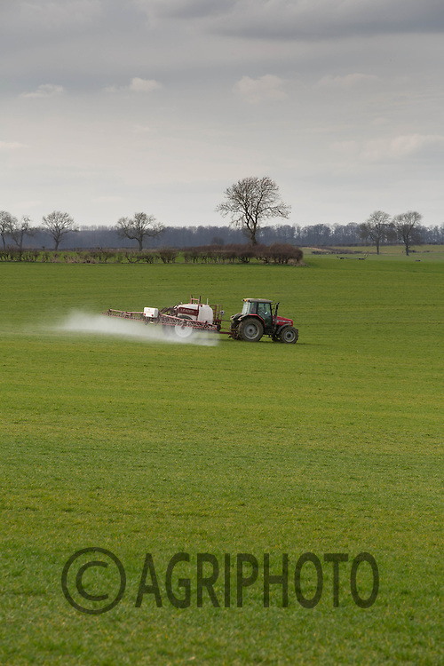 Spraying Winter Barley with a weed control<br /> Picture Tim Scrivener 07850 303986