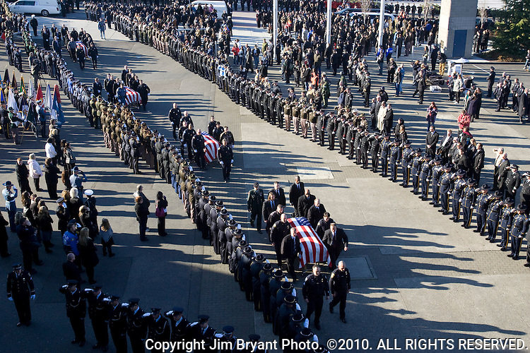 Pallbearers carry the caskets of Lakewood Police Department officers during a memorial service at the Tacoma Dome on December 8, 2009 in Tacoma, WA. Tina Griswold along with sergeant Mark Renninger, officer Ronald Owens and officer Greg Richards were shot and killed at a coffee shop in the Tacoma suburb of Parkland, November 29 by Maurice Clemmons, who was later shot and killed by police.  Jim Bryant Photo. ©2010. ALL RIGHTS RESERVED.