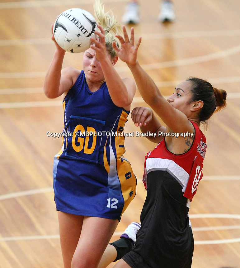 Otago's Storm Purvis, left, and North Harbour's Malia Paseka in the Lion Foundation Netball Championship match, day one, MoreFM Arena, Dunedin, New Zealand, Monday, September 30, 2013.Credit: Dianne Manson/©MBPHOTO /Michael Bradley Photography.