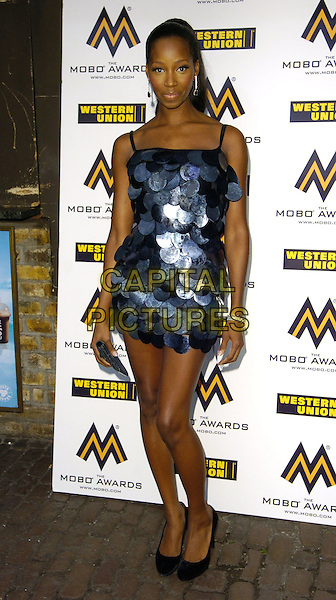 JAMELIA.Attends the 11th Annual MOBO Awards Nominations & Launch at Proud Camden, London, England, .August 15th 2006..full length grey blue and black discs circles retro mini dress legs shoes.Ref: CAN.www.capitalpictures.com.sales@capitalpictures.com.©Can Nguyen/Capital Pictures