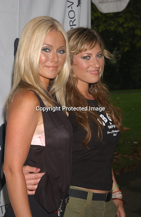 Kelly Ripa and Lucy Woodward                               ..at the Pantene Pro-Voice Concert on August 7,2003 in ..Central Park. Photo by Robin Platzer, Twin Images