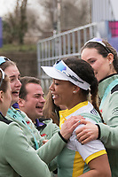 Greater London. United Kingdom, Cambridge Women's squad celebrate, with President, Daphne MARTSCHENKO, on the beach, a double victory in both the Women's races. University Boat Races , Cambridge University vs Oxford University. Putney to Mortlake,  Championship Course, River Thames, London. <br /> <br /> Saturday  24.03.18<br /> <br /> [Mandatory Credit  Intersport Images]