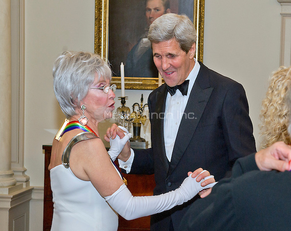 United States Secretary of State John F. Kerry and singer Rita Moreno, one of the five recipients of the 38th Annual Kennedy Center Honors, share a conversation following a dinner hosted by Secretary Kerry in their honor at the U.S. Department of State in Washington, D.C. on Saturday, December 5, 2015.  The 2015 honorees are: singer-songwriter Carole King, filmmaker George Lucas, actress and singer Rita Moreno, conductor Seiji Ozawa, and actress and Broadway star Cicely Tyson.<br /> Credit: Ron Sachs / Pool via CNP/MediaPunch