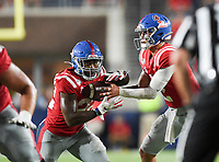 NWA Democrat-Gazette/CHARLIE KAIJO Ole Miss quarterback Matt Corral (2) hands the ball off to running back Scottie Phillips (22) during the third quarter of a football game, Saturday, September 7, 2019 at Vaught-Hemingway Stadium in Oxford, Miss.