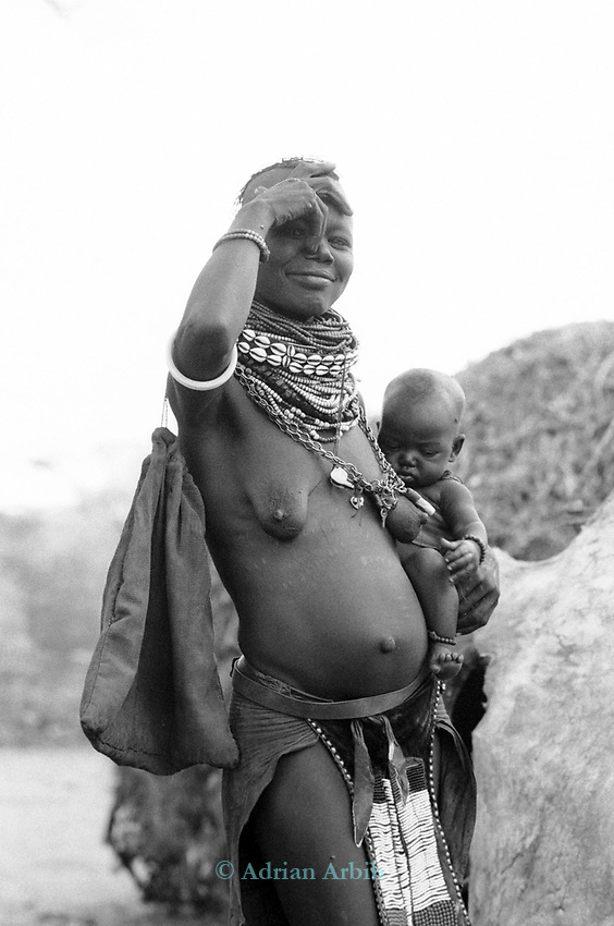 A Turkana woman and child in a traditional village near Kakuma, Northern Kenya.