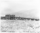 The 12-pocket, double-sided coaling trestle at Dickey.<br /> C&amp;S  Dickey, CO  1935