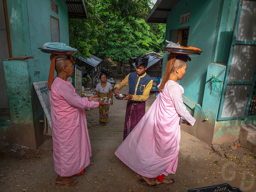 Buddhist Nuns collecting their Alms in the Hills of Sagaing, near Mandalay, Myanmar