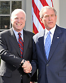 Washington, DC - March 5, 2008 -- United States President George W. Bush, right, shakes hands with United States Senator John McCain (Republican of Arizona), left, the presumptive 2008 Republican nominee for President of the United States after endorsing the Senator's candidacy in the Rose Garden of the White House on Wednesday, March 5, 2008..Credit: Ron Sachs / CNP