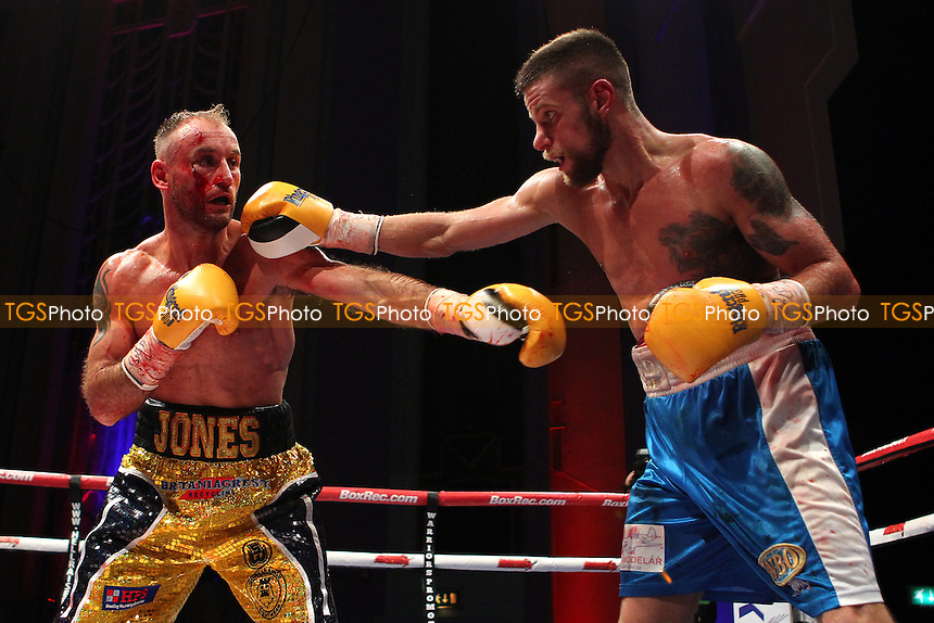Ben Jones (gold/black shorts) defeats Martin Parlagi to win the WBO Inter-Continental Featherweight title during a Boxing Show at The Troxy, Commercial Road, London