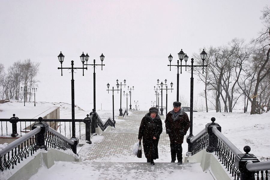Khabarovsk, Russia, 28/02/2004.&amp;#xD;An old couple climb steps from the banks of the frozen Amur river to the city centre.&amp;#xD;<br />
