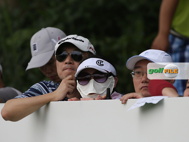 A woman in a mask during the Final Round of the 2014 Volvo China Open, Genzon Golf Club, Shenzhen, China. Picture:  David Lloyd / www.golffile.ie