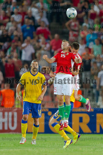 Sweden's Zlatan Ibrahimovic (L) watches as teammate Ola Toivonen (R back) collides with Hungary's Gyorgy Sandor (R front) during the UEFA EURO 2012 Group E qualifier Hungary playing against Sweden in Budapest, Hungary on September 02, 2011. ATTILA VOLGYI