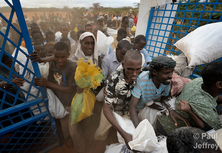 Desperate refugees break through the doorway into a World Food Program compound in the Dadaab refugee camp in northeastern Kenya. Tens of thousands of newly arrived Somalis who have swelled the population of what was already the world's largest refugee camp.