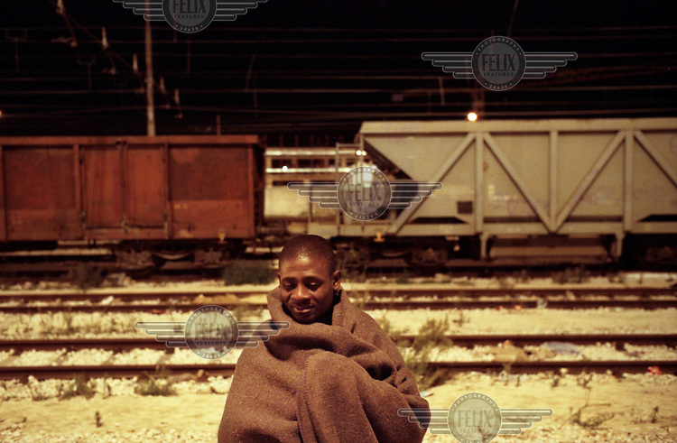 Illegal African migrant living in Foggia train station.
