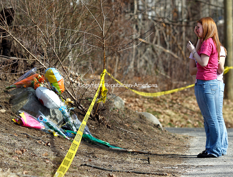 Oxford, CT-02 March 2012-031212CM03-   Seymour High School sophomores Jonah Eames (foreground) and Blake Kravec 15, has moment at a memorial on Old State Road in Oxford where friend, Brandon Giordano was killed in a motor vehicle collision Friday night.      Christopher Massa Republican-American