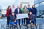 Staff from Liebherr presents the proceeds from their Christmas Raffle to Con O'Connor Pieta House on Friday front row l-r: John McGrath, Kevin Gorman, Back row: Catriona Kelliher, Paul McConologue, Con O'Connor, Michael Morrissey, Bronagh O'Keeffe, Kieran O'Mahony, Mary McGillicuddy