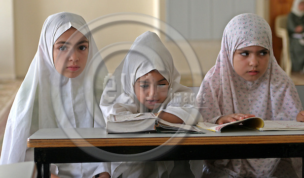 GAZA CITY - GAZA - 21 AUGUST 2007 -- Palestinians girls reads the Muslims holy book of Koran in her religious school in Gaza strip. -- PHOTO: EUP-IMAGES / Thair ALHASSANY