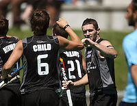 Simon Childs congratulates NZ captain Phillip Burrows for scoring the first goal during the international hockey match between the New Zealand Black Sticks and India at National Hockey Stadium, Wellington, New Zealand on Saturday, 20 February 2009. Photo: Dave Lintott / lintottphoto.co.nz