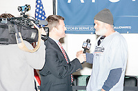 """Fox25 news reporter Blair Miller (center) interviews Dan Stockwell, Jr., of Dublin, New Hampshire, after Vermont senator and Democratic presidential candidate Bernie Sanders spoke to senior citizens at the Peterborough Community Center gymnasium in Peterborough, New Hampshire. Stockwell said he's a strong Sanders supporter, adding that he's also a """"protector."""" Stockwell said, """"We can't protect him enough in this campaign."""""""