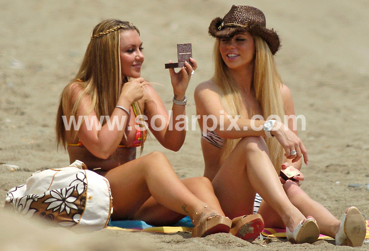 **ALL ROUND PICTURES FROM SOLARPIX.COM**.**WORLDWIDE SYNDICATION RIGHTS**.Pictures show Michelle Heaton and Bianca Gascoine on the beach in Marbella..The two girls were preparing for a calendar shoot and having a good laugh together as they applied their make-up..JOB REF:   4507     CS1 / FTA     DATE: 20.08.07.**MUST CREDIT SOLARPIX.COM OR DOUBLE FEE WILL BE CHARGED* *UNDER NO CIRCUMSTANCES IS THIS IMAGE TO BE REPRODUCED FOR ANY ONLINE EDITION WITHOUT PRIOR PERMISSION*