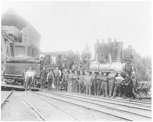 Engine #166 posed with roundhouse workmen.<br /> D&amp;RG  Chama, NM  ca. 1908