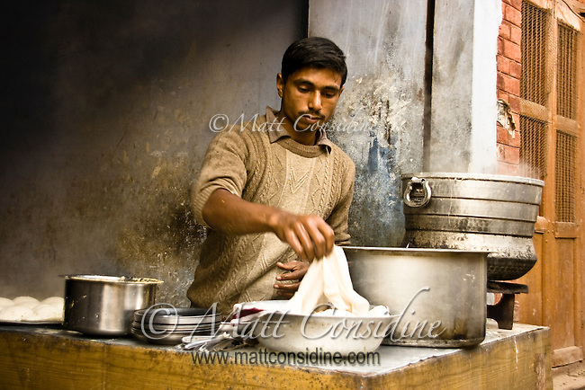 Cook rolling out dough to make chapattis - a kind of whole wheat flat bread.<br /> (Photo by Matt Considine - Images of Asia Collection)