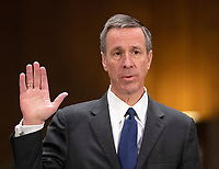 """Arne M. Sorenson, President and Chief Executive Officer, Marriott International, Inc. is sworn-in to testify before the United States Senate Committee on Homeland Security and Governmental Affairs Permanent Subcommittee on Investigations during a hearing on """"Examining Private Sector Data Breaches"""" on Capitol Hill in Washington, DC on Thursday, March 7, 2019.<br /> Credit: Ron Sachs / CNP/AdMedia"""