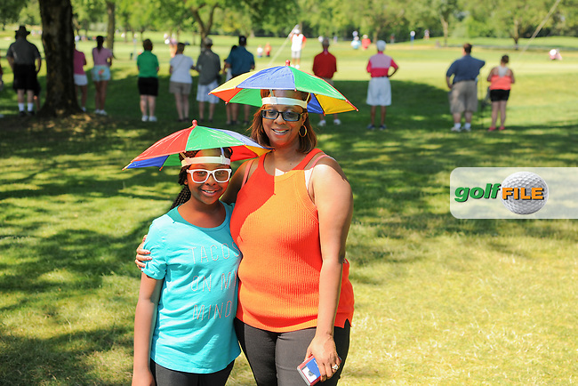 Two avid golf fans sporting umbrella hats providing shade to themselves from the hot summer sun during Saturday's round 3 of the 2017 KPMG Women's PGA Championship, at Olympia Fields Country Club, Olympia Fields, Illinois. 7/1/2017.<br /> Picture: Golffile | Ken Murray<br /> <br /> <br /> All photo usage must carry mandatory copyright credit (&copy; Golffile | Ken Murray)
