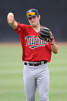 Shortstop Blake Schmit (18) of the Elizabethton Twins warms up before a game against the Johnson City Cardinals on Sunday, July 27, 2014, at Howard Johnson Field at Cardinal Park in Johnson City, Tennessee. The game was suspended due to weather in the fifth inning. (Tom Priddy/Four Seam Images)