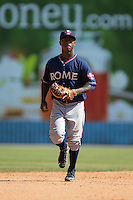 Rome Braves shortstop Ozhaino Albies (7) jogs off the field between innings of the game against the Asheville Tourists at McCormick Field on July 26, 2015 in Asheville, North Carolina.  The Tourists defeated the Braves 16-4.  (Brian Westerholt/Four Seam Images)