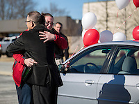 NWA Democrat-Gazette/JASON IVESTER<br /> Keith Brown, owner of Brown's Collision in Bentonville, hugs Missy Lewis, a resident of Havenwood, after presenting her with the keys to a 2003 Honda Civic on Wednesday, Jan. 13, 2016, at the Bentonville business. The donated vehicle was restored and refinished by the company. Havenwood is a center which serves as a transitional housing program for single parents.