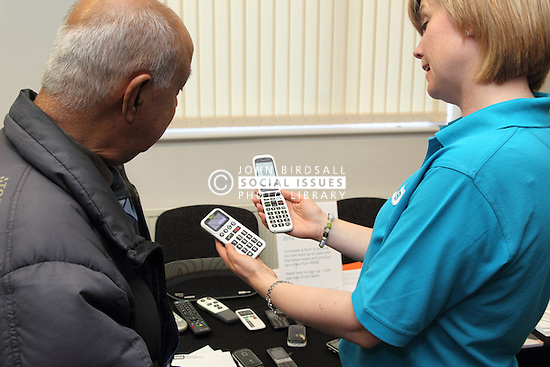 Demonstration mobile phones with large numbers at the Mysight charity for people with visual impairments.
