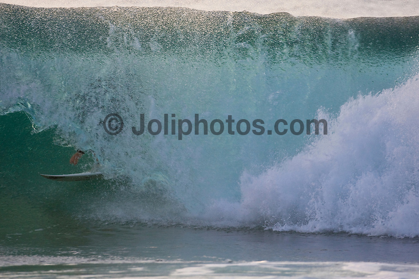 RODRIGO DORNELLES (BRA) surfing at Off The Wall-Backdoor, North Shore of Oahu, Hawaii. Photo: joliphotos.com