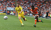 Blackpool's Marc Bola and Fleetwood Town's Wes Burns<br /> <br /> Photographer Stephen White/CameraSport<br /> <br /> The EFL Sky Bet League One - Blackpool v Fleetwood Town - Monday 22nd April 2019 - Bloomfield Road - Blackpool<br /> <br /> World Copyright © 2019 CameraSport. All rights reserved. 43 Linden Ave. Countesthorpe. Leicester. England. LE8 5PG - Tel: +44 (0) 116 277 4147 - admin@camerasport.com - www.camerasport.com