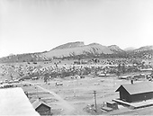 Panorama of Durango looking west - few buildings in photo - early Durango?  Sign on hill - &quot;Moved to Opposite Post Office.&quot;<br /> D&amp;RG  Durango, CO  Taken by Cross, Whitman