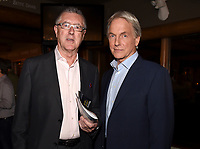 """STUDIO CITY, CA - NOVEMBER 6:  (L-R) Tony Frost and Mark Harmon attend the TV Guide Magazine Cover Party for Mark Harmon and 15 seasons of the CBS show """"NCIS"""" at River Rock at Sportsmen's Lodge on November 6, 2017 in Studio City, California. (Photo by Frank Micelotta/PictureGroup)"""