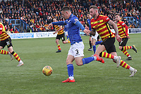 Jordan Marshall being pursued by Christie Elliott in the SPFL Ladbrokes Championship football match between Queen of the South and Partick Thistle at Palmerston Park, Dumfries on  4.5.19.