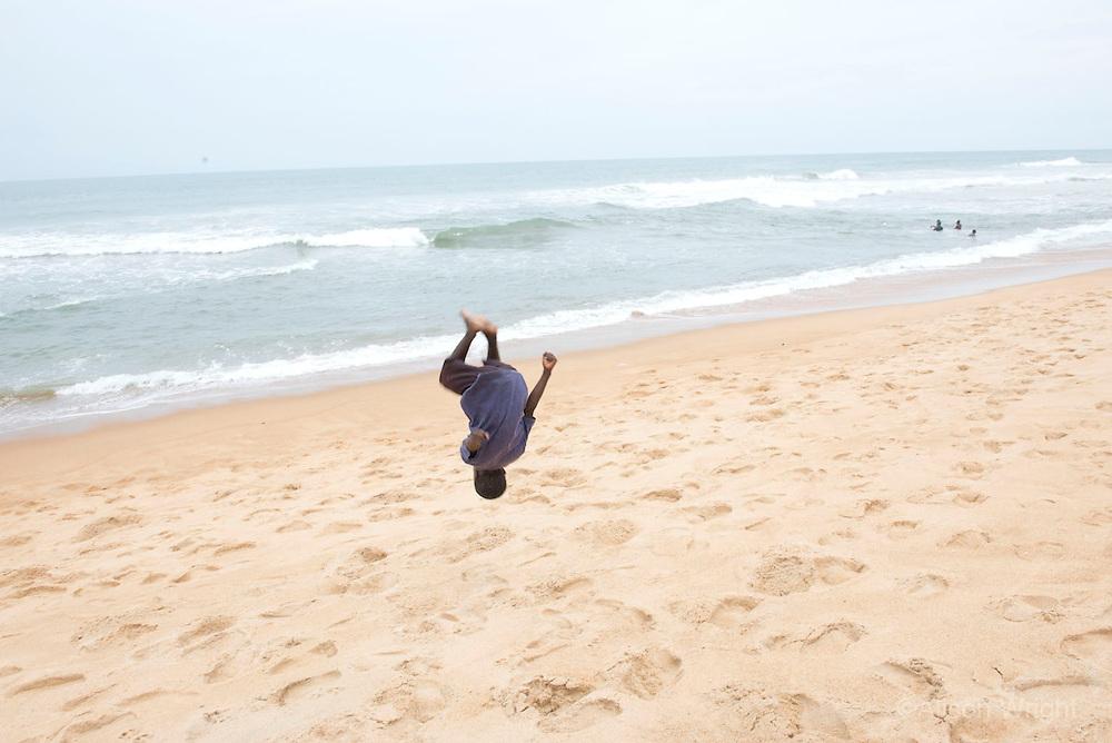 Lumley Beach, Monrovia. Boys doing somersaults. Monrovia, Liberia, Africa