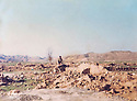 Iraq 1991 .On march 4th, Mahmoud Sangawy seating on the ruins of the house where he was born in the village of Koîk .Irak 1991 .Le 4 mars, Mahmoud Sangawy assis dans les ruines de sa maison natale a Koïk