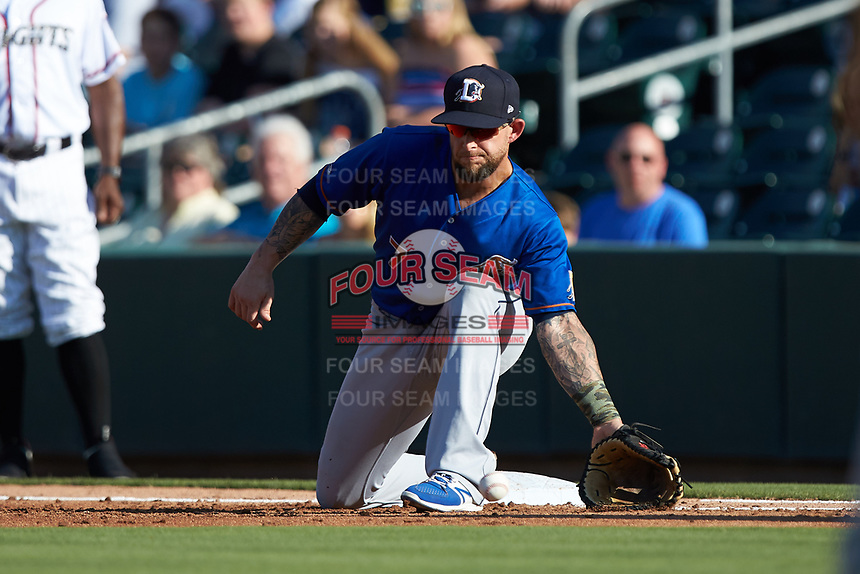 Durham Bulls first baseman Brandon Snyder (7) scoops a low throw during the game against the Charlotte Knights at BB&T BallPark on July 4, 2018 in Charlotte, North Carolina. The Knights defeated the Bulls 4-2.  (Brian Westerholt/Four Seam Images)