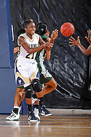 11 November 2011:  FIU's Timeyin Oritsesan (21) passes the ball in the first half as the FIU Golden Panthers defeated the Jacksonville University Dolphins, 63-37, at the U.S. Century Bank Arena in Miami, Florida.
