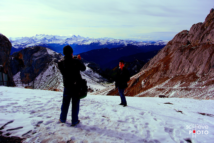 """Tourists visting Mount Pilatus have plenty of photographic opportunities. """"Take one more step back..."""""""