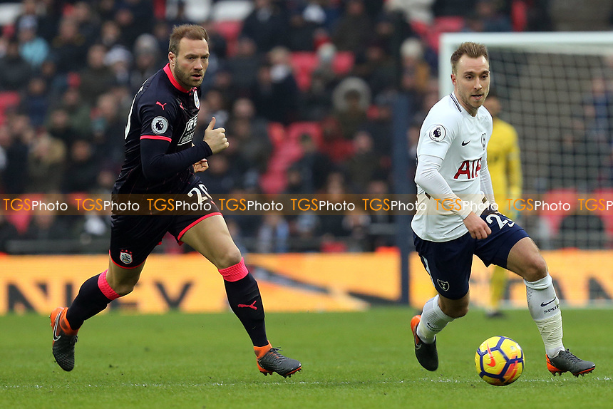 Laurent Depoitre of Huddersfield Town and Christian Eriksen of Tottenham Hotspur during Tottenham Hotspur vs Huddersfield Town, Premier League Football at Wembley Stadium on 3rd March 2018