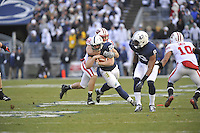 24 November 2012:  Penn State RB Zach Zwinak (28) runs through a tackle by Wisconsin LB Mike Taylor (53). The Penn State Nittany Lions defeated the Wisconsin Badgers 24-21 in OT overtime at Beaver Stadium in State College, PA.