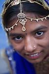 Rajasthani girl in Jodphur wearing decorative head dress and saree, portrait, Jodphur, Rajasthan, India --- Model Released